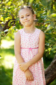 Funny girl in a pink dress — Stock Photo