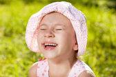 Cheerful girl laughing — Stock Photo