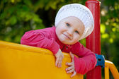 Little girl playing on the playground — Stock Photo