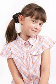 Little funny girl on light background — Stock Photo