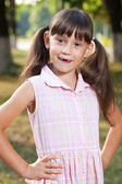 Little girl in a pink dress — Stock Photo