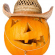 Halloween Pumpkin.Scary Jack O'Lantern in cowboy's cap — Stock Photo #13162674
