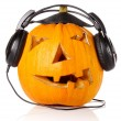 Halloween Pumpkin.Scary Jack O'Lantern in headphones — Stock Photo