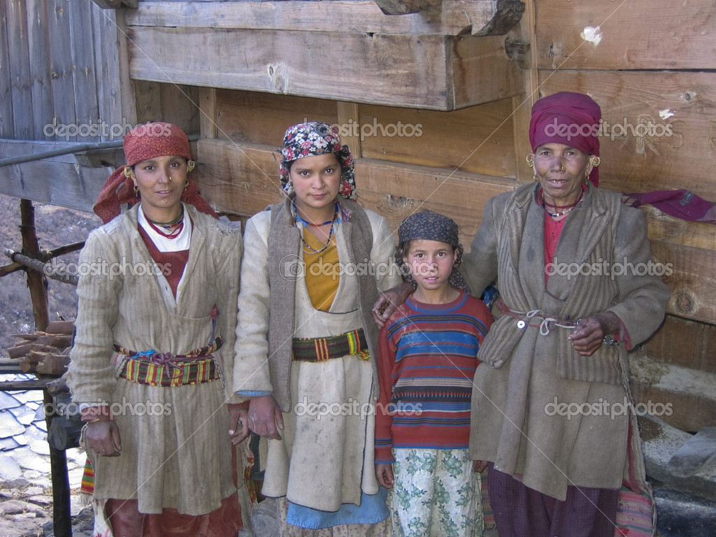 Group of women and children dressed in homemade clothes in a remote mountain village in the Himalaya Mountains of India  Stock Photo #10979542
