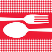 Cutlery on red tablecloth — Stock Vector