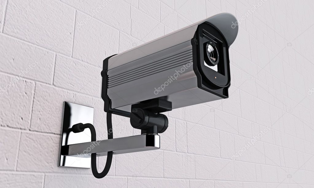 Security camera on tiled wall — Stock Photo #11376018