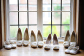 Bride and bridesmaids shoes — Stock Photo