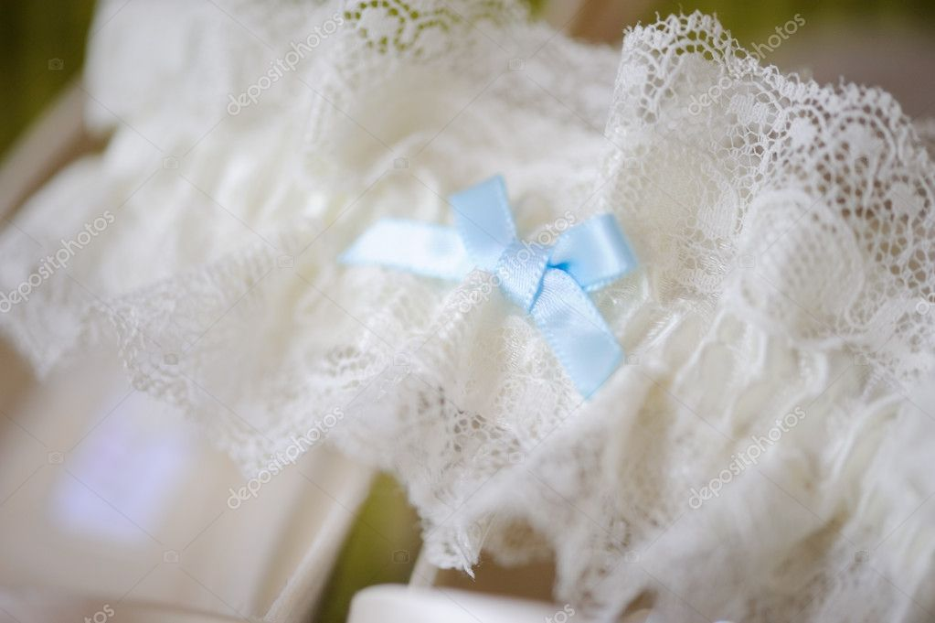 Brides garter closeup at wedding — Stock Photo #11866696