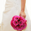 Royalty-Free Stock Photo: Bride holding pink bouquet