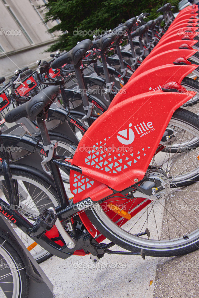 Lille, France - 13th July, 2012. Part of the fleet of rental bikes available for the public to hire in Lille, France. The service known as V'lille, founded in 2011, is one of many established across Europe in recent years — Stock Photo #11941263
