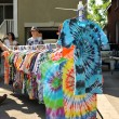 Tie-dye shirts at garage sale — Stock Photo