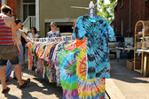 Tie-dye shirts at garage sale — Stock Photo