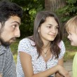 Teen couple with little girl - Stockfoto