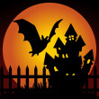 Halloween night haunted house with bat — Stock Vector #11556599