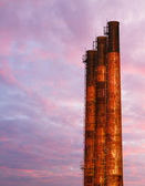 Three Smokestack and Sunrise Sky — Stock Photo