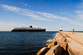 Ship and Ludington Light — Stock Photo