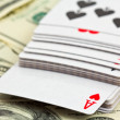 Playing cards on a money background — Stock Photo #10756075