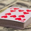 Playing cards pack on a money background — Stock Photo #10921127