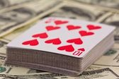 Playing cards pack on a money background — Stock Photo