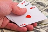 Show three ace on a money background — Stock Photo