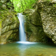 Small waterfall in a mountains — Stock Photo