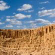 High sandy wall in a desert — Stock Photo