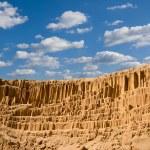 High sandy wall in a desert — Stock Photo