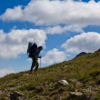 Hiker ascending upwards — Stock Photo