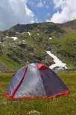 Touristic tent in a mountains — Stock Photo