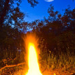 Night scene campfire and moon — Stock Photo