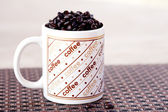 Fresh Coffee beans in a cup — Stock Photo