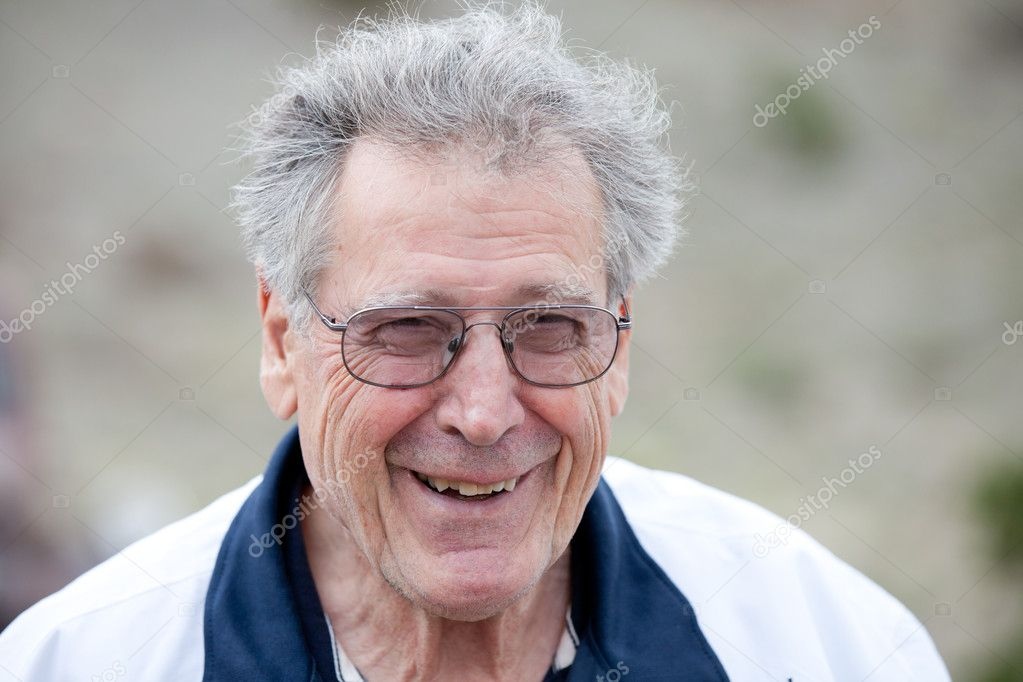 Happy Senior Man Smiling and laughing outdoors with a full head of grey hair — Stock Photo #11074932