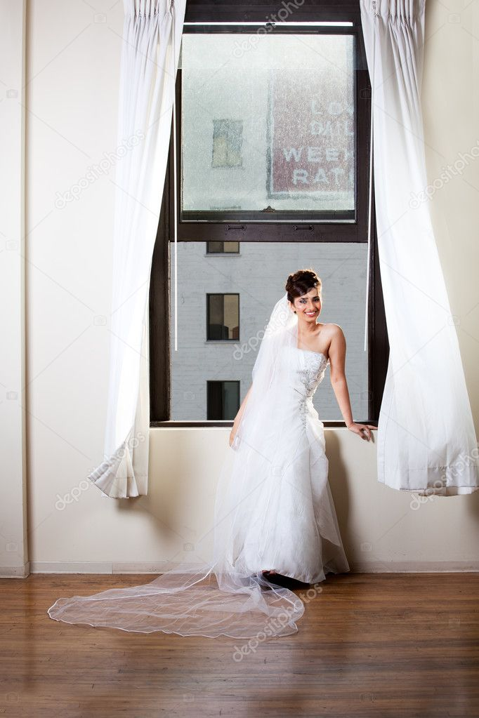 Beautiful Bride in a window with city behind her — Stock Photo #11262856