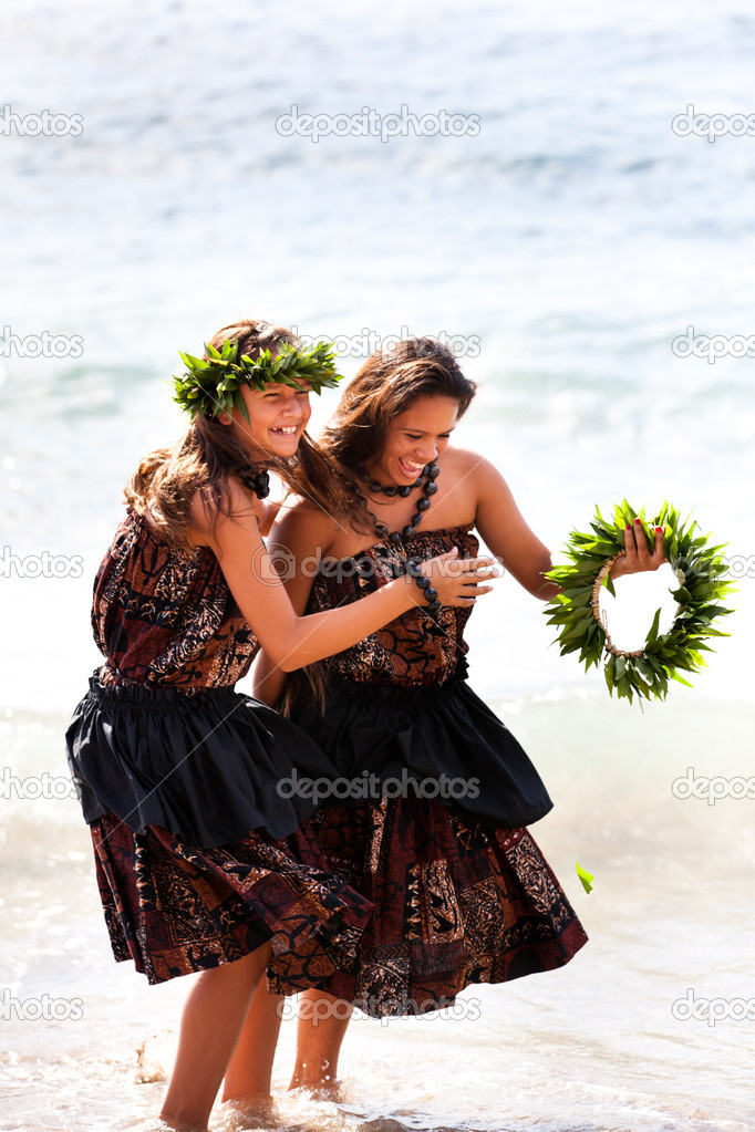 Hula girls on the beach laughing and playing in the water — Stock Photo #11317721