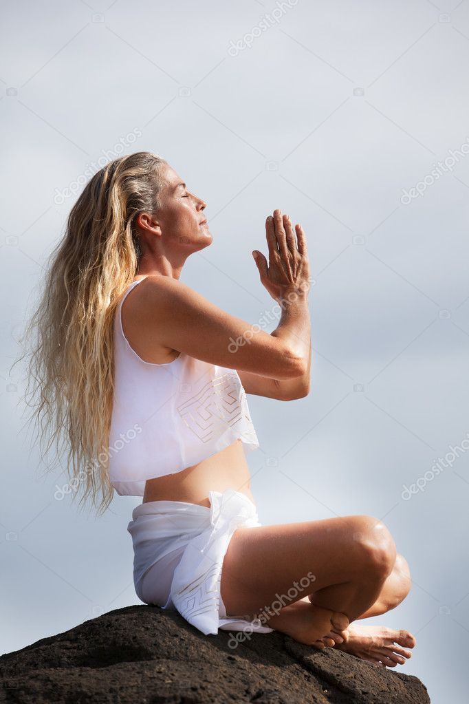 Beautiful woman with long hair in her Forties Meditating in Hawaii on a Lava bed — Stock Photo #12226234