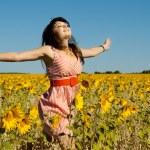 Beautiful woman runs on a glade — Stock Photo #11699772