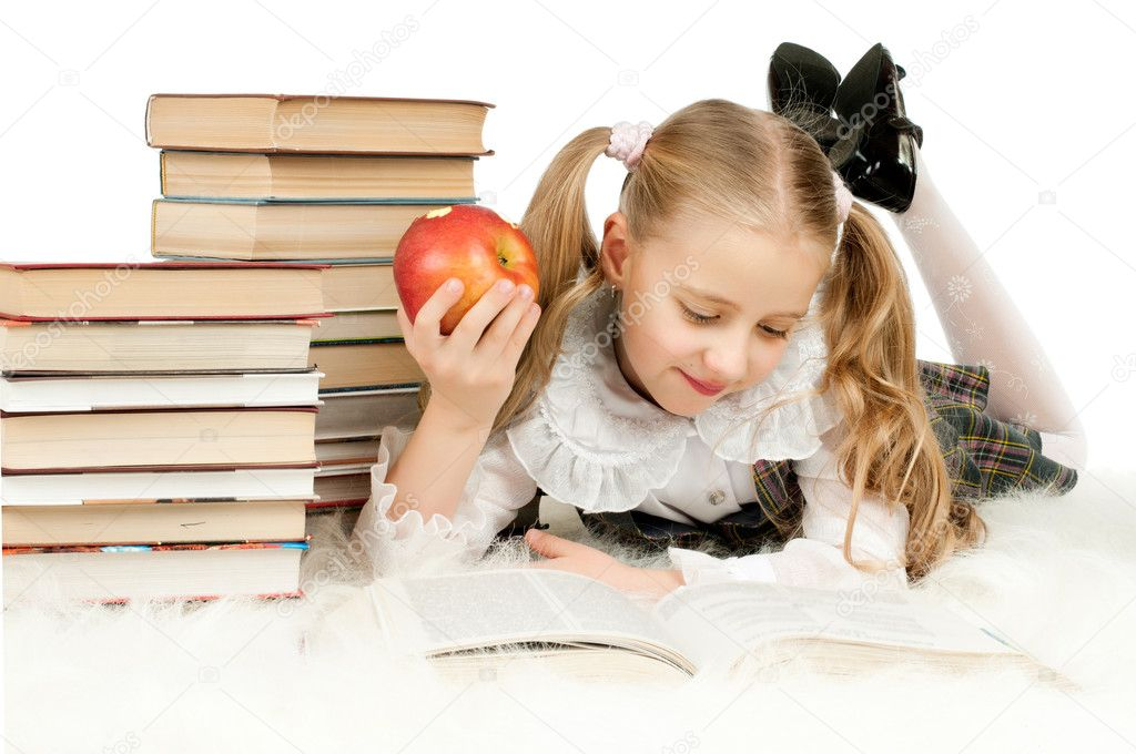 The cute little teen girl lie, read big textbook, eat apple, ...