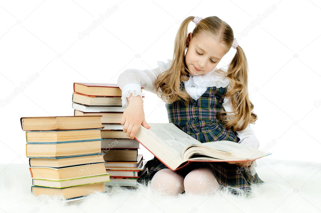 The cute little teen girl sit, read big textbook, on white background, ...