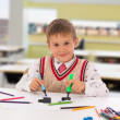 Portrait of a young boy sitting at his desk at school — Stock Photo #10816344