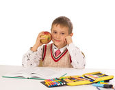Portrait of a young boy in school at the desk — Stock Photo