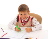 Portrait of a young boy sitting at his desk at school — Stock Photo