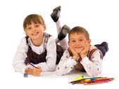 Two kids drawing on the floor — Stock Photo
