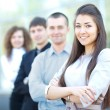 A business team with pretty leader in front looking at camera and smiling — Stock Photo #12170427