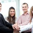 Closeup of business team putting their hands on top of each other — Stock Photo #12170609