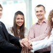 Closeup of business team putting their hands on top of each other — Stock Photo