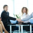 Stock Photo: Business shaking hands, finishing up a meeting