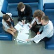 Top view of working business group sitting at table during corporate meeting — Stock Photo