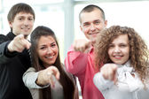 Happy diverse group of executives all pointing at you — Stock Photo