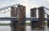 Construction of a bridge across the river — Stock Photo