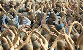Crowd at a concert with hands up — Stock Photo